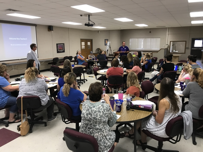 Administration talks with new teachers and Interlocal staff.