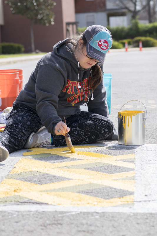 Art student paints crosswalk